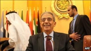 Amr Moussa smiling as he sits at his last meeting at the Arab League HQ in Cairo in May 2011