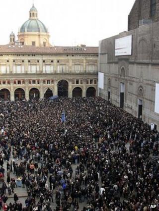 A crowd gathers outside the St Petronio Basilica for the funeral of Italian singer Lucio Dalla, Bologna, Italy (4 March 2012)