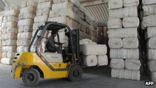 Bales of cotton for export are stacked at Inland Container Depot (ICD) in Sanand, some 30 kms from Ahmedabad, Gujarat state, India - 10 February 2012