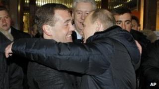 Russian President Dmitry Medvedev, left, and Prime Minister Vladimir Putin 04 March 2012