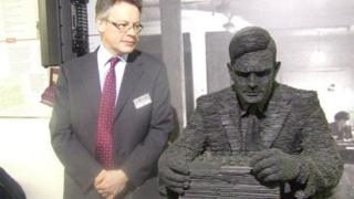 Sir John Dermot Turing and statue of Alan Turing