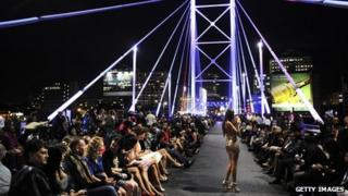 A model on Nelson Mandela Bridge during Africa Fashion Week, Feb 2011
