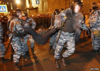 Riot police remove a protester in Moscow, 5 March