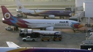 Planes that belong to Thailand's budget carrier Nok Air stands at gates at Bangkok's Don Muang airport, 6 March 2012