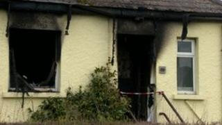 The woman was dead when firefighters arrived at the house