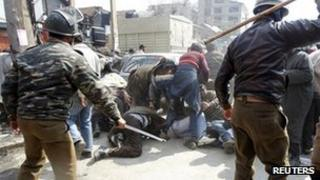 Police use batons on protesters in Srinigar, Indian-administered Kashmir - 23 February 2012