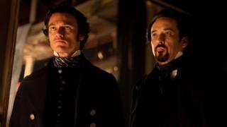 Luke Evans and John Cusack in the Raven