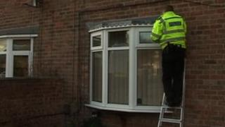 Policeman applying Smartwater to Nottinghamshire house
