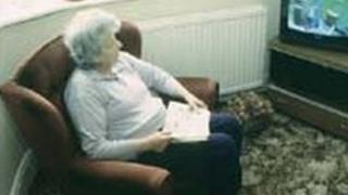 Pensioner sitting in her home