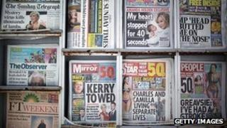Selection of Sunday newspapers on a newsstand
