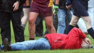 A man lying on the pitch after violence at the Tyrone ladies match