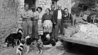 The family pictured outside the farm house in 1955 (Pic: Geoff Charles Collection, National Library of Wales)