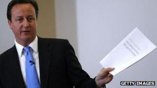 David Cameron with a copy of the Coalition Agreement