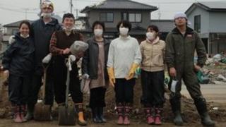 Hina Oishi's family wearing boots and masks in Ishinomaki. Copyright: Hina Oishi