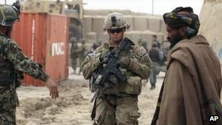 US soldiers and an Afghan man outside a military base in Panjwai, Kandahar province