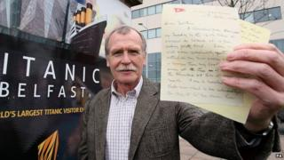 Dr John Martin holding a copy of the letter written by his great uncle whilst aboard the Titanic