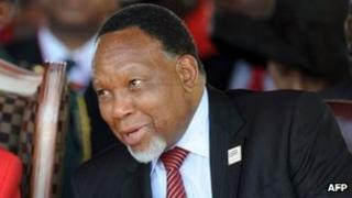 """South African deputy president Kgalema Motlanthe (R) attend a rally to celebrate BDP""""s 50th anniversary on February 25, 2012 in Gaborone"""