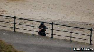 Armed policeman on Saltburn seafront. Photo taken by Phil Barnes