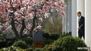 Mr Obama moves towards a podium in the White House Rose Garden 13 March 2012