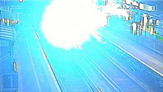 The explosion as the train hits the bike
