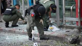 Thai bomb squad officials inspect the site of an explosion in Bangkok on February 14