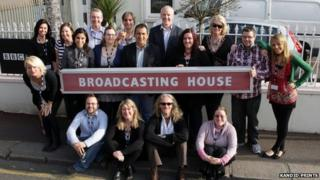 BBC Radio Jersey staff with the Broadcasting House sign