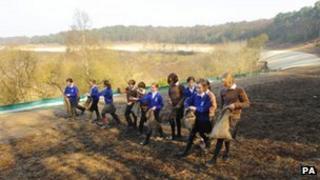 Children sowing heather seeds