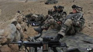 French soldiers of the battle group Picardie keep watch during an operation in Usbeen village, in Surobi district of Kabul province on March 15, 2012