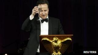 Prime Minister David Cameron raises his glass in a toast an official dinner 14 March 2012