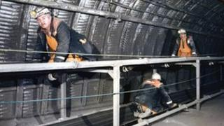 Workers on manriding conveyor at Daw Mill
