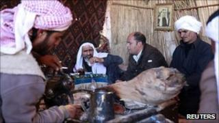 Bedouin men sit at a tribal meeting in North Sinai