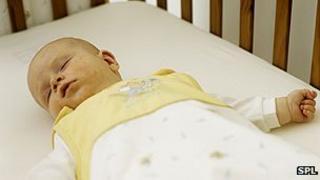 Sleeping baby in cot