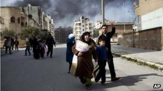 A family escapes from fierce fighting in Idlib, 10 March