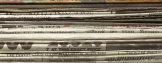 Stack of folded newspapers