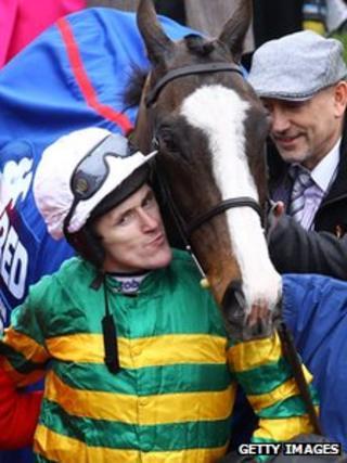Jockey Tony McCoy celebrates his win on Synchronised