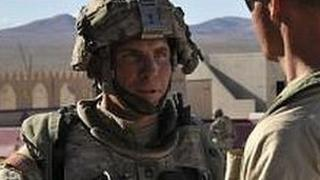Photo said to show Sgt Robert Bales posted on a military website (left)