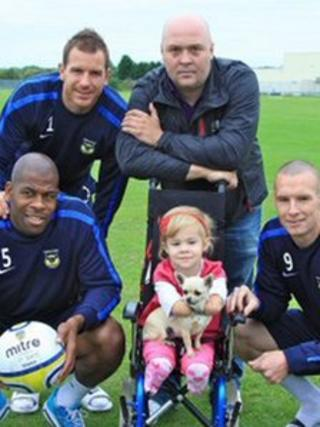 Charlotte Nott with Oxford United players