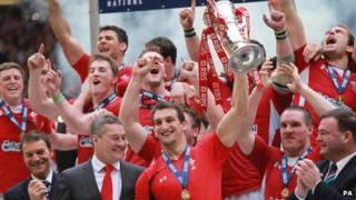 Wales celebrate the Grand Slam with the Six Nations trophy