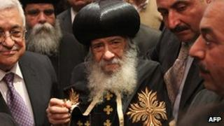 Pope of the Coptic Orthodox Church of Alexandria Shenouda III (C) meets with Palestinian president Mahmoud Abbas (L) at the Abassiya headquarters in Cairo, Egypt - 7 April 2011