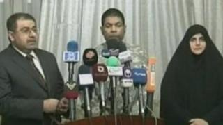 Still from video of pre-recorded news conference announcing release of US man (centre) - 17 March 2012