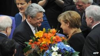 Joachim Gauck is congratulated by Angela Merkel at the Bundestag. Photo: 18 March 2012