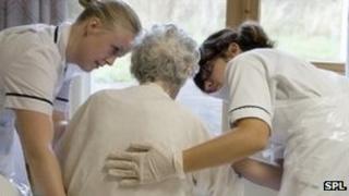 Nurses with elderly patient