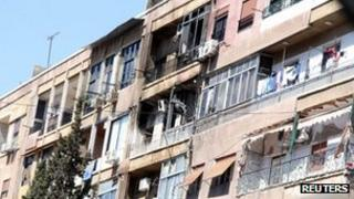 Apartment buildings damaged by fighting in Damascus