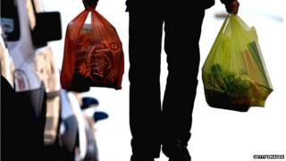 Man carrying two carrier-bags of shopping