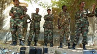 Ethiopian soldiers displaying weapons belonging to Somali militants 2 March 2012