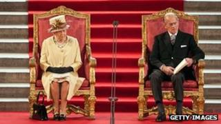 Queen Elizabeth II sits next to Prince Philip, Duke of Edinburgh
