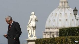 Prime Minister Mario Monti of Italy checks his phone in Rome, 20 March