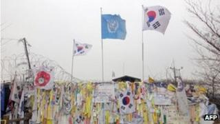Messages of hope for reunification on a military barbed wire fence at Imjingak peace park in Paju near the Demilitarized Zone (DMZ) separating the two Koreas, 14 March, 2012
