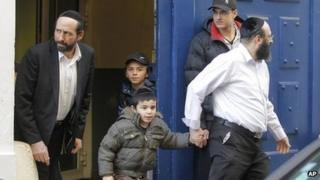 French schoolchildren leave a Jewish school in Paris on 19 March, a day after the shootings at a Jewish school in Toulouse