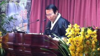 Pastor Kim at his Sunday service
